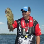 Jeremy with smallmouth bass that hit a vibrating jig