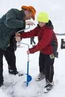 Drill a hole for ice fishing