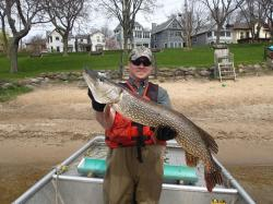 David Rowe holds a northern pike